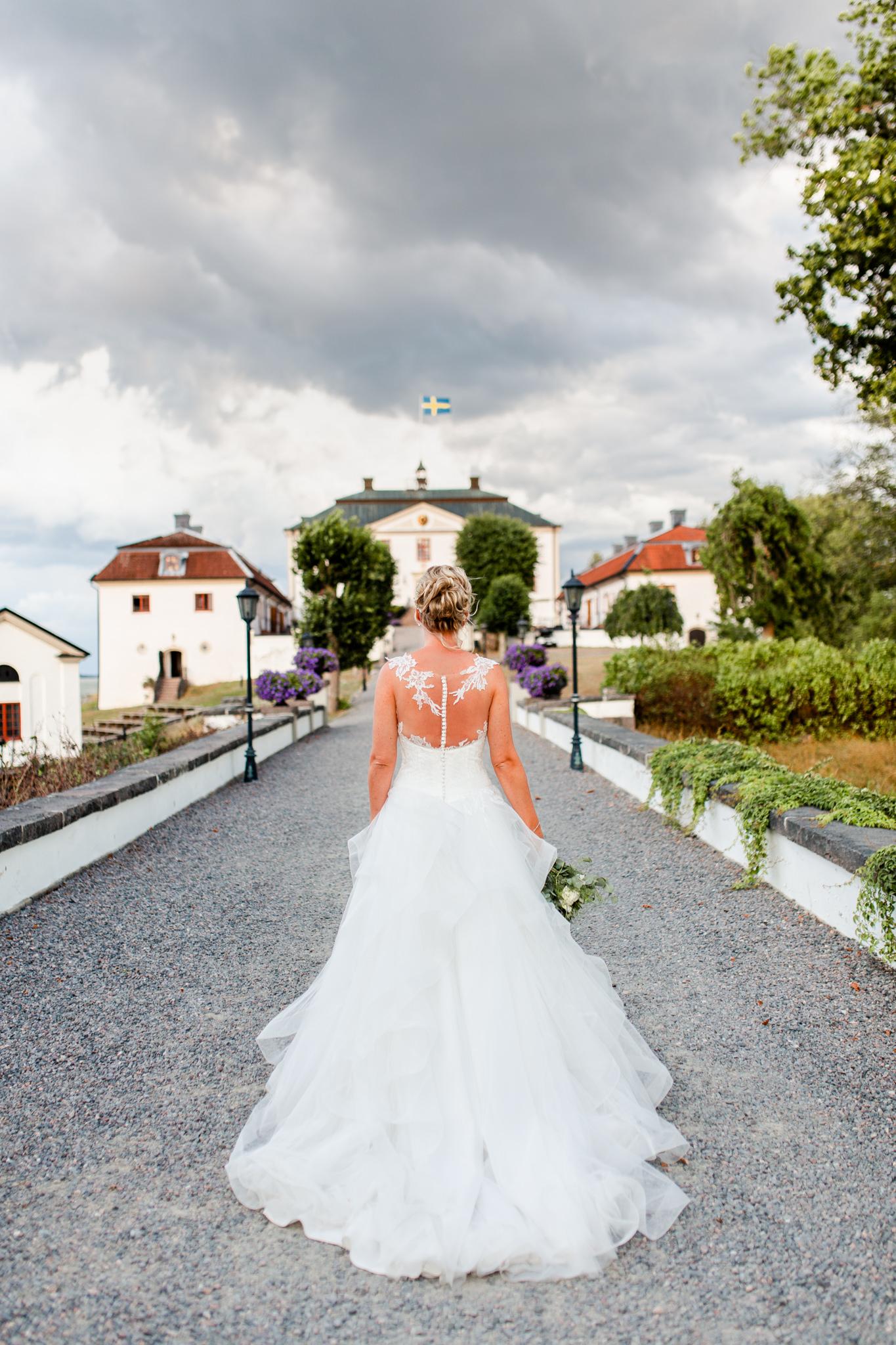Brudklänning bröllopsfotografering Mauritzberg Slott